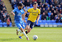 Adil Nabi of Peterborough United in action with Tom Hopper of Scunthorpe United - Mandatory by-line: Joe Dent/JMP - 23/04/2016 - FOOTBALL - ABAX Stadium - Peterborough, England - Peterborough United v Scunthorpe United - Sky Bet League One