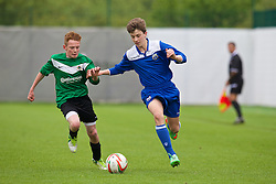 NEWPORT, WALES - Wednesday, May 28, 2014: South WPL Academy Boys' Dan Edmunds and Central WPL Academy Boys' James Milne [green] during the Welsh Football Trust Cymru Cup 2014 at Dragon Park. (Pic by David Rawcliffe/Propaganda)