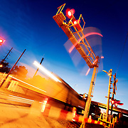 Train motion blur before sunrise in the East Bottoms area of Kansas City, Missouri on Montgall Avenue, by Knuckleheads and J Rieger Distillery. Union Pacific Railroad intermodal activities.