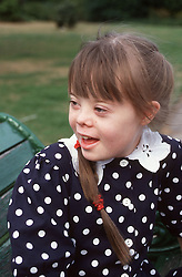 Portrait of young girl with Downs Syndrome laughing,