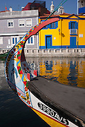 Typical landscape on the Canal de S. Roque with the bow of a traditional Moliceiro boat and the background of brightly painted traditional homes, on 18th July, at Aveira, Portugal. The Moliceiro is the name given to Portuguese boats which use Ria de Aveiro lagoon area of Rio Vouga. They were originally used for the harvesting of seaweed but are nowadays used for tourism. (Photo by Richard Baker / In Pictures via Getty Images)