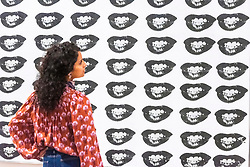 © Licensed to London News Pictures. 10/03/2020. Gallery staff view artwork titled Maryilyn Monroe's Lips, 1962, by artist Andy Warhol at an exhibition showing at the Tate Modern. London, UK. Photo credit: Ray Tang/LNP