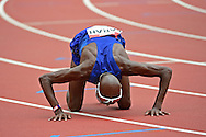 Mo Farah (GBR) kisses the track after winning the 5000m during the Muller Anniversary Games at the Stadium, Queen Elizabeth Olympic Park, London, United Kingdom on 23rd July 2016. Photo by Jon Bromley.