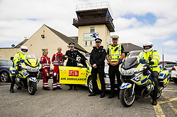 Pictured: Constable Neil Drummond, Aircrew Paramedics John Pritchard and Julia Barnes, Chief Constable Phil Gormley, Sergent Peter Lorrain-Smith, Sergent Paul Taylor and Constable Eric McNee<br /> The Scottish Police Benevolent Fund has donated £30,000 to help fund Scotland's Charity Air Ambulance (SCAA). Police Scotland Chief Constable Phil Gormley and Scottish Police Benevolent Fund secretary David Hamilton visited SCAA in Perth to thank them for their work. <br /> <br /> Ger Harley | EEm 16 May April 2016