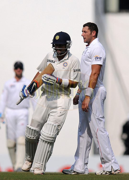 Virat Kohli of India avoids a collusion with Tim Bresnan of England as he completes a run during day three of the 4th Airtel Test Match between India and England held at VCA ground in Nagpur on the 15th December 2012..Photo by  Pal Pillai/BCCI/SPORTZPICS .