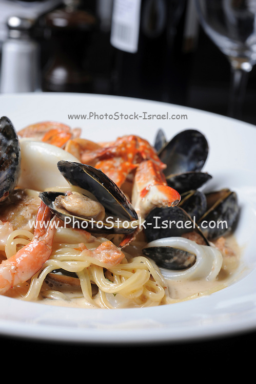 Seafood plate with mussels, shrimps and squid steamed in wine