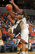 Feb. 3, 2011; Charlottesville, VA, USA; Wake Forest Demon Deacons guard Chelsea Douglas (5) shoots in front of Virginia Cavaliers center Simone Egwu (4) during the game at the John Paul Jones Arena.  Mandatory Credit: Andrew Shurtleff