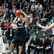 Efes Pilsen's Ender ARSLAN (C) during their Turkish Basketball league derby match Besiktas between Efes Pilsen at the BJK Akatlar Arena in Istanbul Turkey on Saturday 30 April 2011. Photo by TURKPIX