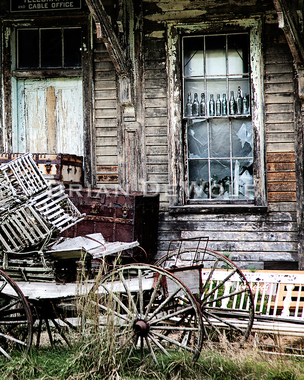Antiques and collectables stacked outside a vintage train station in Wells, Maine seem a vain attempt for permanence.
