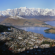 Queenstown, New Zealand, with the snow capped Remarkables mountain range providing a stunning backdrop. Queenstown is nestled on the shores of the crystal clear waters of Lake Wakatipu in the Central Otago region of the South Island of New Zealand. Queenstown is New Zealand's premier tourist destination providing an abundance of year round outdoor activities for both young and old. Queenstown, Central Otago, South Island, New Zealand. Photo Tim Clayton.