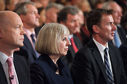 Conservative Party Conference, ICC, Birmingham, Great Britain <br /> 10th October 2012 <br />  Day 4<br /> <br /> Rt Hon David Cameron MP <br /> Prime minister <br /> keynote speech <br /> <br /> William Hague Theresa May Jeremy Hunt watching speech <br /> <br /> Photograph by Elliott Franks<br /> <br /> United Kingdom<br /> Tel 07802 537 220 <br /> elliott@elliottfranks.com<br /> <br /> ©2012 Elliott Franks<br /> Agency space rates apply