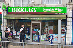 © Licensed to London News Pictures. 16/04/2019.<br /> Bexley, UK. According to local reports a shopkeeper has been stabbed this afternoon in Bexley, South London. Local press are reporting that police are hunting six men in connection with the attack. Police are on guard outside Bexley food and wine shop in Bexley.  Photo credit: Grant Falvey/LNP