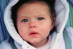 Portrait of baby girl dribbling,
