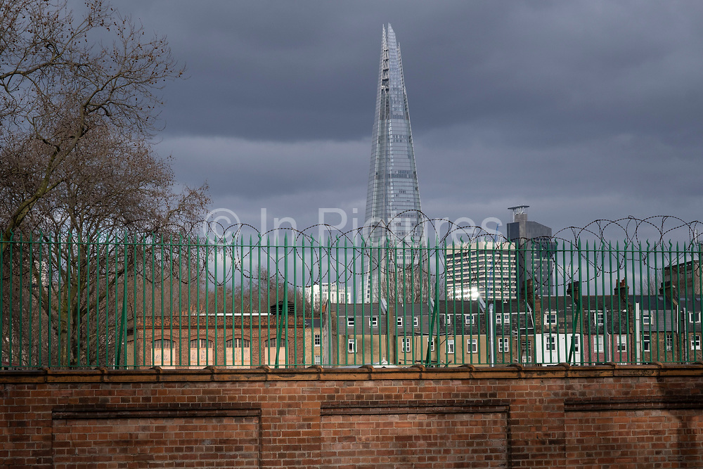 The Shard seen from a distance near surrounding buildings in Borough on 5th March 2021 in London, England, United Kingdom. The Shard, also referred to as the Shard of Glass, Shard London Bridge and formerly London Bridge Tower, is an 87-storey skyscraper in London that forms part of the London Bridge Quarter development.