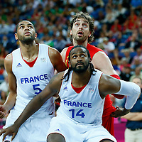 08 August 2012: France Ronny Turiaf and Nicolas Batum vie for the rebound with Spain Pau Gasol during 66-59 Team Spain victory over Team France, during the men's basketball quarter-finals, at the 02 Arena, in London, Great Britain.