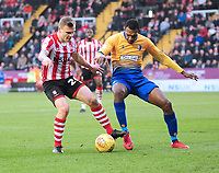 Lincoln City's Harry Anderson vies for possession with Mansfield Town's Krystian Pearce<br /> <br /> Photographer Andrew Vaughan/CameraSport<br /> <br /> The EFL Sky Bet League Two - Lincoln City v Mansfield Town - Saturday 24th November 2018 - Sincil Bank - Lincoln<br /> <br /> World Copyright © 2018 CameraSport. All rights reserved. 43 Linden Ave. Countesthorpe. Leicester. England. LE8 5PG - Tel: +44 (0) 116 277 4147 - admin@camerasport.com - www.camerasport.com