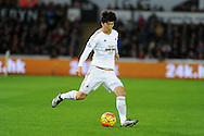 Ki Sung-Yueng of Swansea city in action. Barclays Premier league match, Swansea city v West Ham Utd at the Liberty Stadium in Swansea, South Wales  on Sunday 20th December 2015.<br /> pic by  Andrew Orchard, Andrew Orchard sports photography.