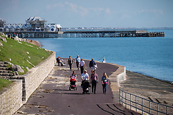 © Licensed to London News Pictures. 09/10/2015. Southsea, Hampshire, UK. People enjoying the warm and sunny October weather next to the Solent at Southsea, Hampshire. Photo credit : Rob Arnold/LNP