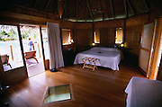 The interior of a vacation hut on the water in Tahiti
