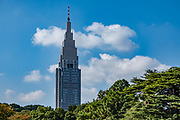 """The NTT Docomo Yoyogi Building rises above Shinjuku Gyoen National Garden, in Shinjuku ward, Tokyo, Japan. At 240 metres (790 ft) tall, this skyscraper is the fourth tallest building in Tokyo. It mainly houses technical and switching equipment for the company's cellular telephone service, plus some offices. Shinjuku Gyoen originated during the Edo Period (1603-1867) as a feudal lord's Tokyo residence. Later it was converted into a botanical garden before being transferred to the Imperial Family in 1903 who used used it for recreation and the entertainment of guests. The park was almost completely destroyed during World War II, but was eventually rebuilt and reopened in 1949 as a public park. Access Shinjuku Gyoen park via three gates: Shinjuku Gate is a ten minute walk east from the """"New South Exit"""" of JR Shinjuku Station or a five minute walk from Shinjukugyoenmae Station on the Marunouchi Subway Line. Okido Gate is a five minute walk from Shinjukugyoenmae Station on the Marunouchi Subway Line. Sendagaya Gate is a five minute walk from JR Sendagaya Station on the local Chuo/Sobu Line."""