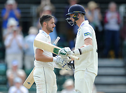 Jack Taylor of Gloucestershire celebrates with Craig Miles of Gloucestershire as he hits his personal best of 156 runs- Photo mandatory by-line: Dougie Allward/JMP - Mobile: 07966 386802 - 09/07/2015 - SPORT - Cricket - Cheltenham - Cheltenham College - LV=County Championship 2