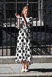 © Licensed to London News Pictures. 05/07/2020. London, UK. Clap for Carers founder AnneMarie Plas  claps outside Downing St to mark the 72nd anniversary and to thank staff for their work in tackling the coronavirus pandemic. Photo credit: Ray Tang/LNP