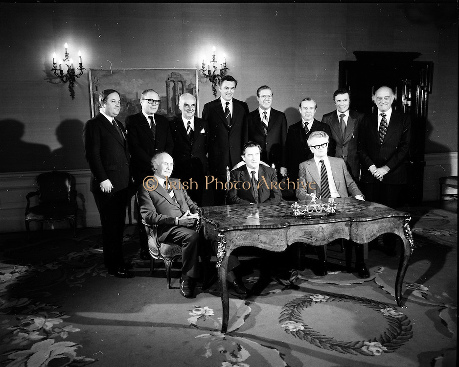 29/03/1976<br /> 03/29/1976<br /> 29 March 1976<br /> Petroleum exploration licences signed at Iveagh House, Dublin. Minister for Industry and Commerce, Mr Justin Keating T.D. and senior oil company executives representing the firms to which licences were being granted signed petroleum exploration licences in respect of exploration offshore of Ireland. Image shows the Minister (centre, front row) with Padraig O'Slatarra (left, front row), Secretary, Dept. of Industry and Commerce; J.C. Holloway, (right, front row), Assistant Sec., Dept. of Industry and Commerce and the eight signatories of the agreements. From left: <br /> Dr Guido Schurmeyer, Managing Director, Deminex Group;<br /> Mr K.D. Soule, President, Amoco Group;<br /> Mr P. Guillaumat, Chairman, Elf Aquitaine Group;<br /> Mr P.W.J. Wood, President, Ireland-Cities Services Inc. Group;<br /> Mr J.W. Rogers, Managing Director, Texaco Group; <br /> Dr Jack Birks, Head of Exploration, BP for Aran-BP Group; <br /> Mr J.J. Newman, Director, Ranger Oil for Ranger-Petroswede Group;<br /> Mr W.A. Roberts, Executive Vice-President Philips Group.