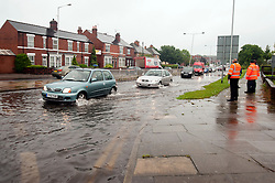 Torrential  rain causes flooding on Saint Annes Road off Centenary Way Parkgate Rotherham..6 July 2012.Image © Paul David Drabble