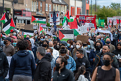 © Licensed to London News Pictures. 16/05/2021. Oxford, UK. People hold placards and flags at the 'Speak up for Palestine' demonstration held in Oxford, the crowd marched on the planned route from Manzil Way to Bonn Square in central Oxford. Photo credit: Peter Manning/LNP
