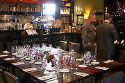 Table set for lunch guests with many wine glasses for tasting and knives and forks and other silverware. The O'Farrell Restaurant, Acassuso, Buenos Aires Argentina, South America