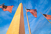 The Washington Monument and American flags at sunset on the National Mall, Washington DC.