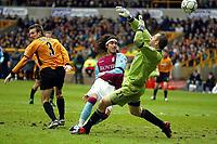 Photo: Scott Heavey.<br /> Wolverhampton Wanderers v Aston Villa. FA Barclaycard Premiership. 14/03/2004.<br /> Juan Pablo Angel lobs the ball over Paul Jones for Villa's third