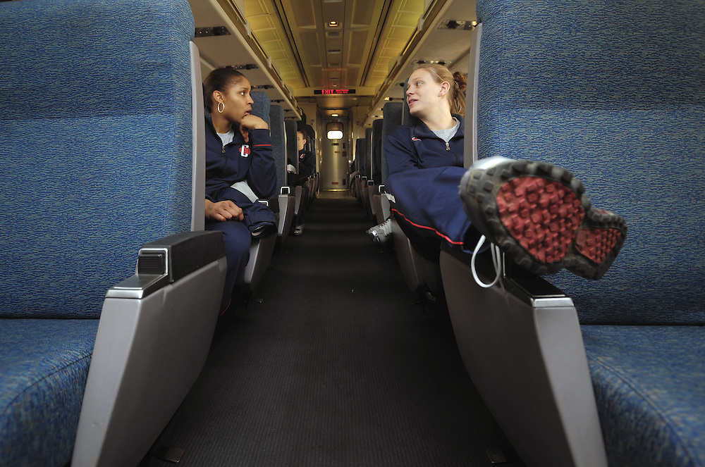 Connecticut's Maya Moore, left, and Heather Buck, right, talk to each other on a train ride out of New London, Conn., on Friday, Jan. 22, 2010.  The team is traveling by train to Philadelphia for their NCAA college women's basketball game against Villanova on Saturday.  (AP Photo/Jessica Hill)