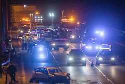© Licensed to London News Pictures. 01/04/2020. Gerrards Cross, UK. Emergency vehicles and a damaged car on the southbound carriageway of the M40 motorway between junction 2 and junction 1a. The M40 motorway was closed in both directions due to a Road Traffic collision involving a heavy goods vehicle and at least to cars. Photo credit: Peter Manning/LNP