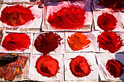 Powdered paints for facial paintings and decoration on sale at street stall at the Sonepur animal fair, Bihar, India.