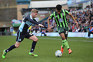 Jason McCarthy of Wycombe Wanderers challenges Lyle Taylor of AFC Wimbledon (r). Skybet football league two match, Wycombe Wanderers  v AFC Wimbledon at Adams Park  in High Wycombe, Buckinghamshire on Saturday 2nd April 2016.<br /> pic by John Patrick Fletcher, Andrew Orchard sports photography.