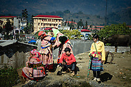 Vietnam, Bac Ha. Flower Hmong women at the Sunday market in Bac Ha.