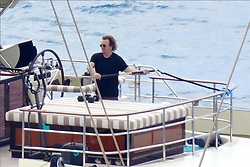 EXCLUSIVE: U2 frontman, Bono is spotted as he lifts free weights while on a large yacht during a holiday in St. Barth's. 20 Jan 2020 Pictured: Bono. Photo credit: EliotPress / MEGA TheMegaAgency.com +1 888 505 6342