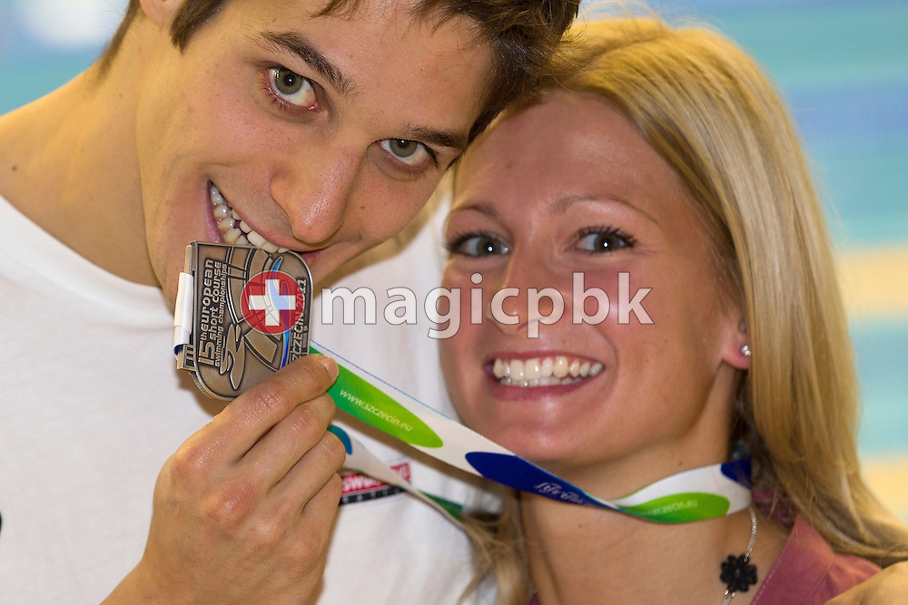 Flori LANG (L) of Switzerland, silver medalist in the 50m Backstroke final, poses with his girlfriend Annamaria and his silver medal during the 15th European Short Course Swimming Championships in Szczecin, Poland, Sunday, Dec. 11, 2011. (Photo by Patrick B. Kraemer / MAGICPBK)