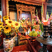 A shrine with tributes at the Temple of the Jade Mountain (Ngoc Son Temple) on Hoan Kiem Lake in the heart of Hanoi's Old Quarter. The temple was established on the small Jade Island near the northern shore of the lake in the 18th century and is in honor of the 13-century military leader Tran Hung Dao.