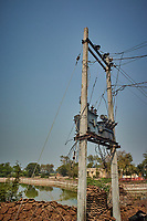 Power Lines and Cow Pies in a Village Near Bharatpur, India. Image taken with a Nikon 1 V3 camera and 10-30 mm VR lens (ISO 200, 11.6 mm, f/5.6, 1/2000 sec)