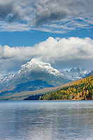 Peaks along Lake McDonald dusted in snow from autumn storm, Glacier National Park Montana USA