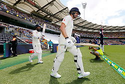 England's Moeen Ali and Dawid Malan walk out to bat during day two of the Ashes Test match at The Gabba, Brisbane.