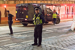 June 3, 2017 - London, London, UK - LONDON, UK.  Police have blocked the road and made a cordon in Tooley Street, to the south east of London Bridge.  A van and knife attack have been reported to have taken place on London Bridge this evening. (Credit Image: © Vickie Flores/London News Pictures via ZUMA Wire)