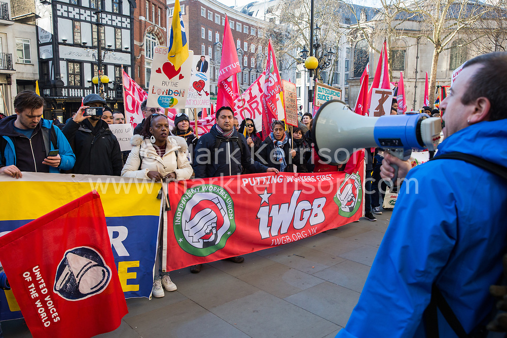 London, UK. 26th February, 2019. Jason Moyer Lee, General Secretary of the Independent Workers of Great Britain (IWGB), addresses mainly migrant striking outsourced workers belonging to the IWGB, United Voices of the World (UVW) and Public and Commercial Services Union (PCS) trade unions working at the University of London (IWGB), Ministry of Justice (UVW) and Department for Business Energy and Industrial Strategy (PCS), together with representatives of the National Union of Rail, Maritime and Transport Workers (RMT) Regional Council, taking part in a 'Clean Up Outsourcing' demonstration to call for an end to the practice of outsourcing. The demonstration was organised to coincide with a significant High Court hearing of an application by the IWGB for judicial review of a decision by the Central Arbitration Committee (CAC) not to hear their application for trade union recognition for the purposes of collective bargaining with the University of London.