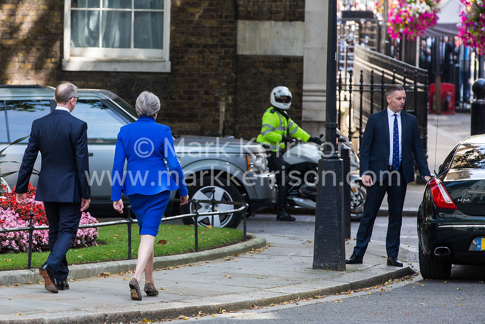 London, UK. 24 July, 2019. Theresa May, accompanied by her husband Philip, walks to her car after addressing the nation outside 10 Downing Street to make her way to Buckingham Palace to tender her resignation to the Queen.