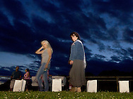 Goshen, New York - People walk laps around the track, which is lined with luminaria in remembrance of cancer victims, during the Relay for Life at Goshen High School on June 16, 2012. The Relay for Life is the American Cancer Society's signature fundraising event. Participants celebrate the lives of people who have battled cancer, remember loved ones lost, and fight back against the disease by raising money.