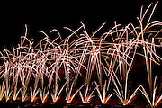 A colorful display of fireworks lights up the sky.