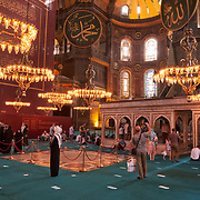 Visitors take photos inside Hagia Sophia mosque, Istanbul, Turkey