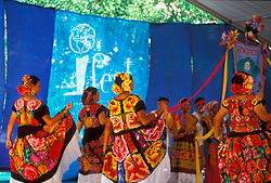 Stock photo of a group of women dancing in traditional native clothing at the International Festival in downtown Houston Texas